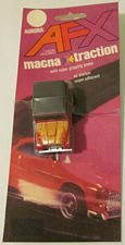 AFX Magna Traction Jeep CJ7 in red with yellow, mint on card.