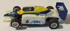 Tomy F1 Road Hawk in white with yellow and blue #6