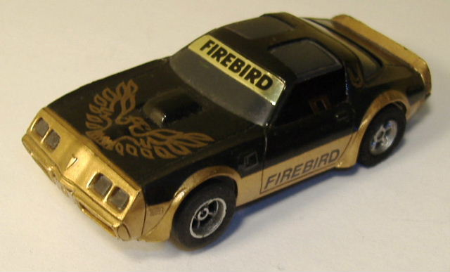 http://slotcarcollectibles2.homestead.com/files/Tomy_bk_gold_Firebird1.JPG