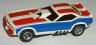 AFX Plymouth Cuda funny car slot car, white with red and blue side stripes.