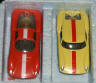Red Dino Ferrari and yellow Lola GT, from sealed Thunderjet set